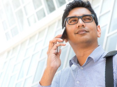 young Indian man calling from mobile device